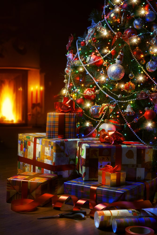 Gifts-beneath-Christmas-tree-in-the-dark