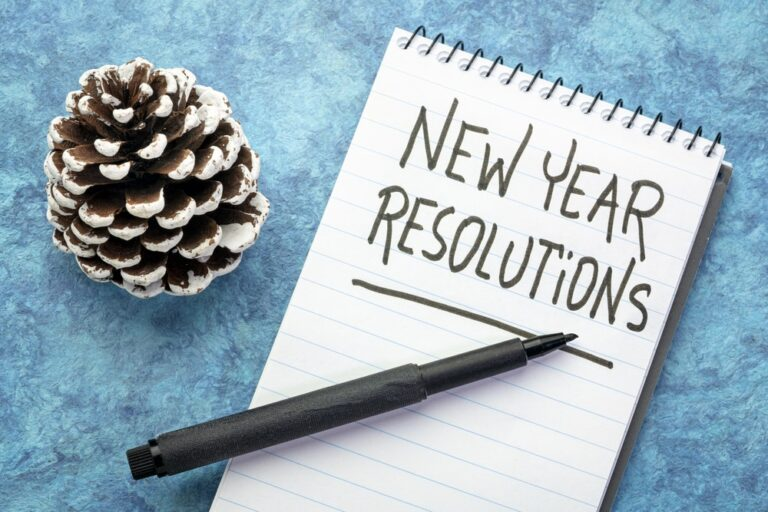 New-Year-Resolutions-written-on-notebook-pen-pinecone