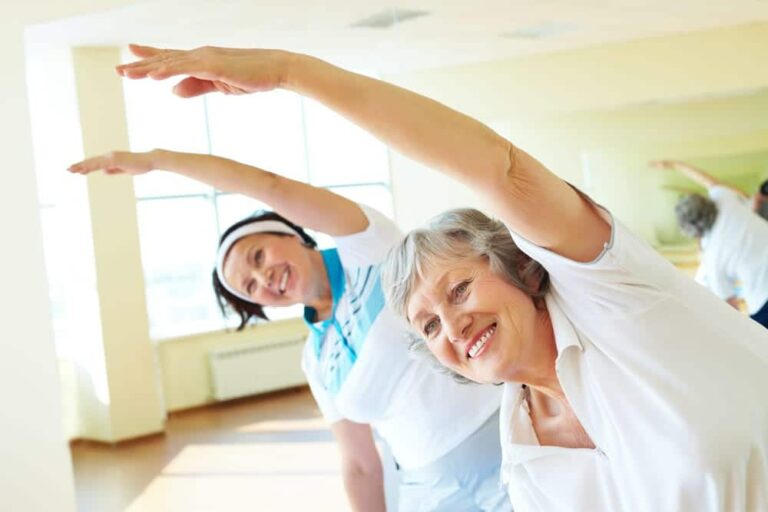 Two-senior-women-stretching-and-smiling